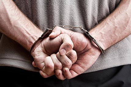 Man in handcuffs - Criminal Defense Attorneys - Gruszeczki & Smith Law
